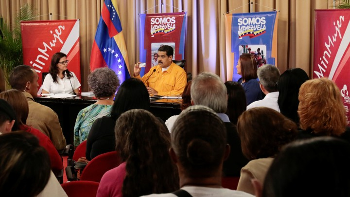 Maduro holds a copy of the constitution during a meeting with supporters on July 11, 2017.