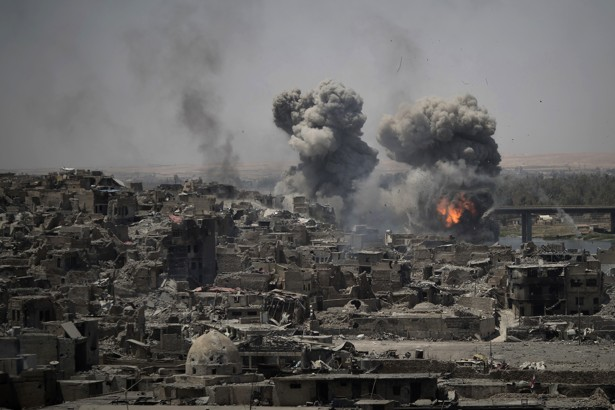 Airstrikes target ISIS positions on the edge of the Old City on July 11, 2017.