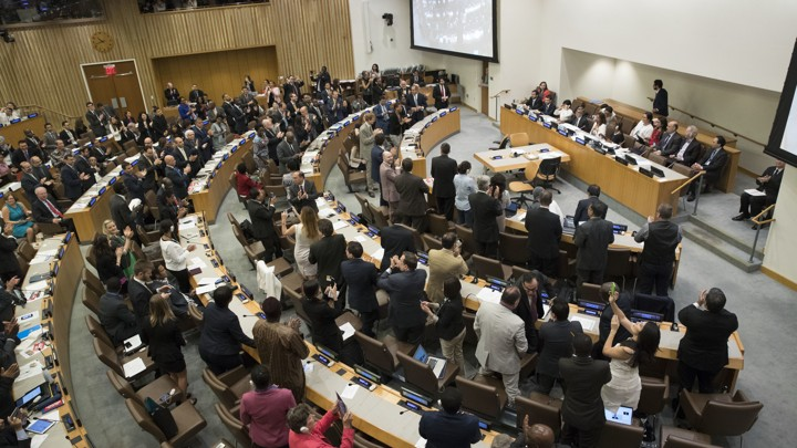 Delegates give a standing ovation after approving the treaty on July 7, 2017.