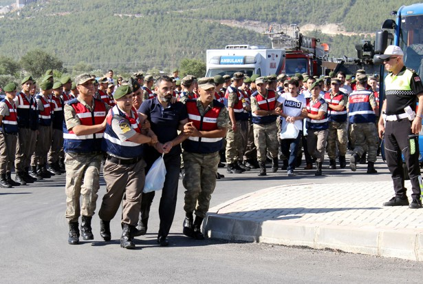 Soldiers accused of attempting to assassinate President Erdogan on the night of the failed coup are escorted to court on July 13, 2017.