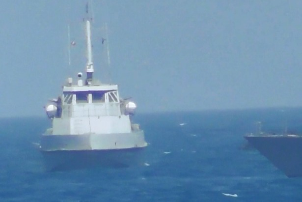 An Iranian vessel steers close to the USS Thunderbolt on July 25, 2017.