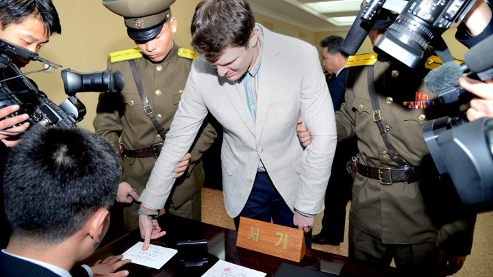 U.S. student Otto Warmbier has his fingerprints taken at North Korea's top court.