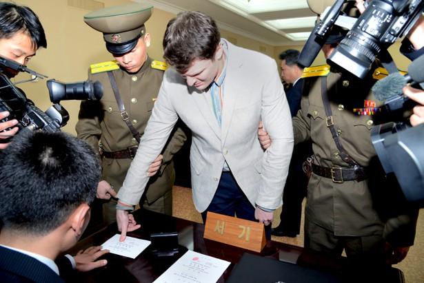 U.S. student Otto Warmbier has his fingerprints taken at North Korea's top court.