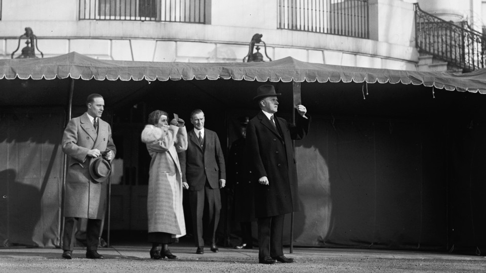 President Calvin Coolidge watches a total solar eclipse from the White House lawn on January 24, 1925.