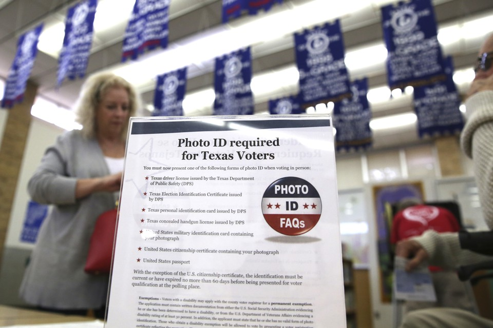 Federal judge throws out Texas voter ID law