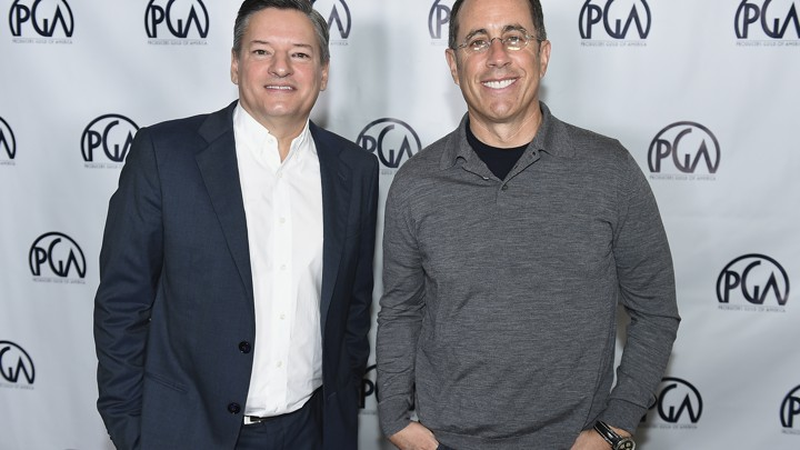 Netflix's chief content officer Ted Sarandos stands next to the comedian Jerry Seinfeld.