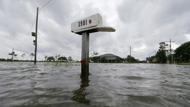 A mailbox is partially underwater after flooding in Big Lake, Louisiana, in June.