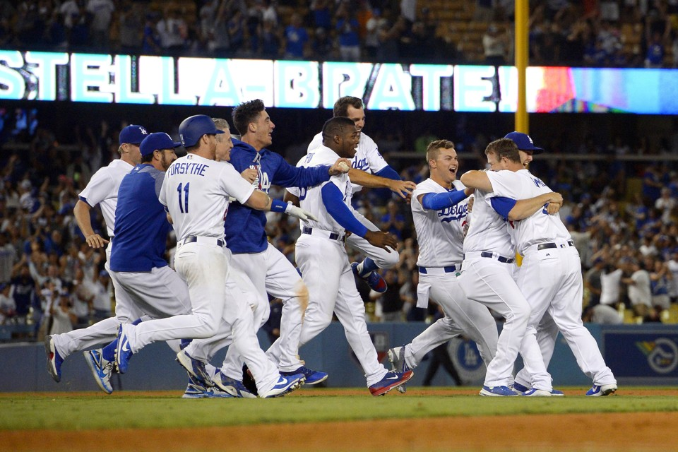 The Dodgers celebrate a win against the San Francisco Giants.