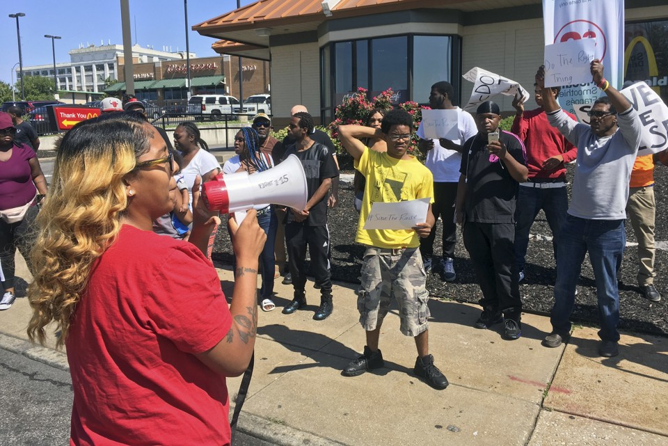Activists rally for St. Louis businesses to keep higher wages despite a state law capping the minimum wage.