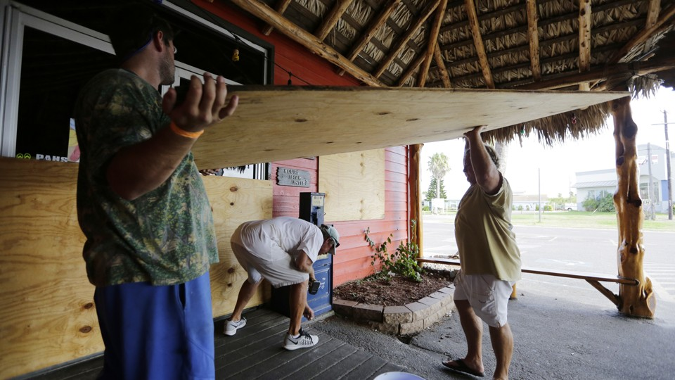 Business owners in Port Aransas, Texas, board up in expectation of Hurricane Harvey.