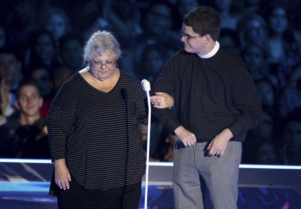 Susan Bro, mother of Charlottesville victim Heather Heyer, and Rev. Robert Lee IV present the award for Best Fight Against the System at the MTV VMAs