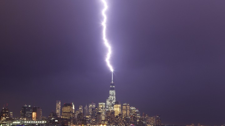 Lightning strikes One World Trade Center in New York.