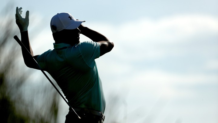 The professional golfer Gary Woodland loses grip of his club during a swing.