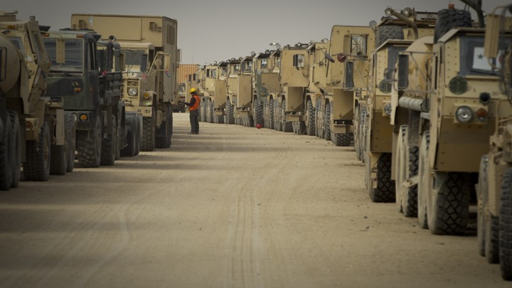 A contractor inspects U.S. military equipment used in Iraq and due to be shipped home or to Afghanistan.