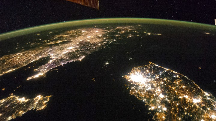 A view of Earth from space with artificial lights at night