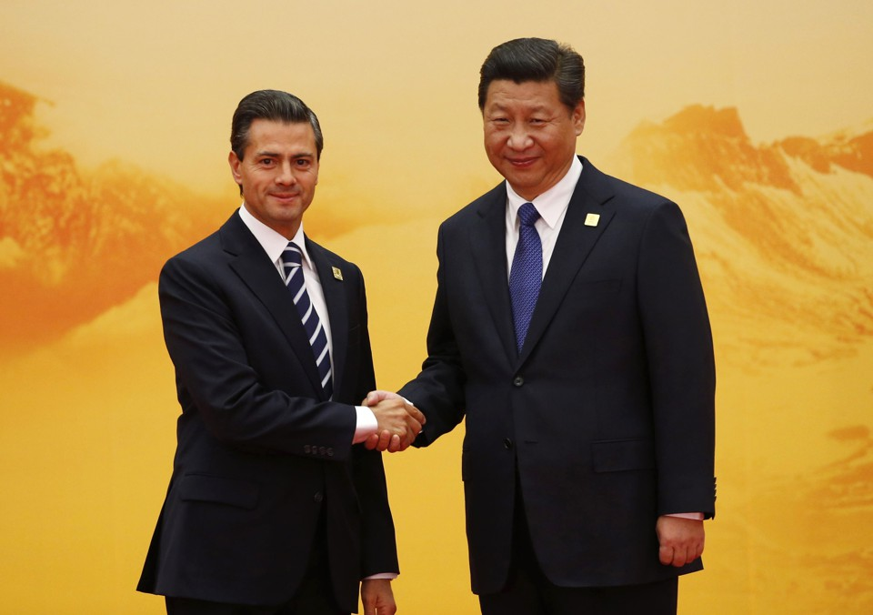 Mexico's President Nieto shakes hands with China's President Jinping.