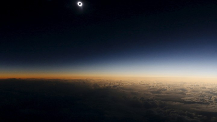 A total solar eclipse as seen from the window of a plane