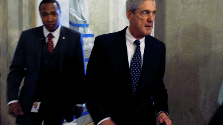 Special Counsel Robert Mueller, right, leaves the U.S. Capitol Building on June 21, 2017.