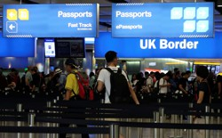 Travelers line up at the U.K. border control at Heathrow Airport in London on July 30, 2017.