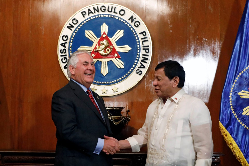 Philippine President Rodrigo Duterte shakes hands with visiting U.S Secretary of State Rex Tillerson