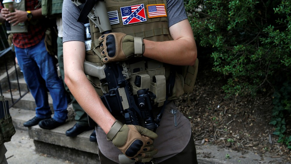 The chilling effects of openly displayed firearms the atlantic a member of a militia stands near a rally in charlottesville virginia august 12 fandeluxe Image collections