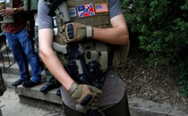 A member of a militia stands near a rally in Charlottesville, Virginia, August 12, 2017.
