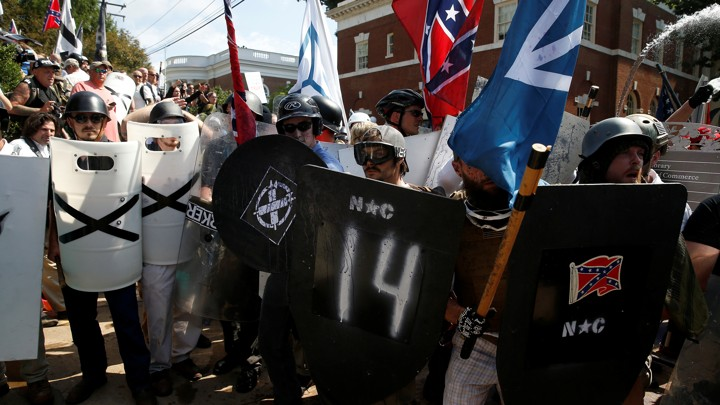 White supremacists stand behind their shields at a rally in Charlottesville, Virginia.