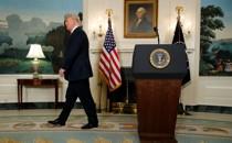 Donald Trump walks away from his podium.