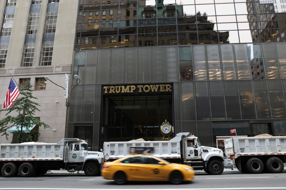 Dump trucks form a protective cordon around Trump Tower during an August visit by the president.