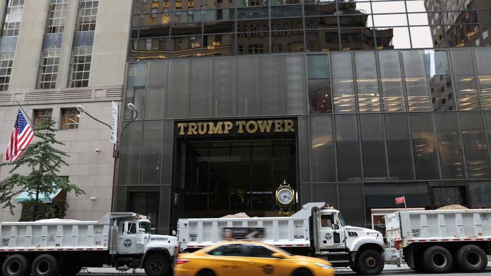 Dump trucks form a protective cordon around Trump Tower during an August  visit by the president