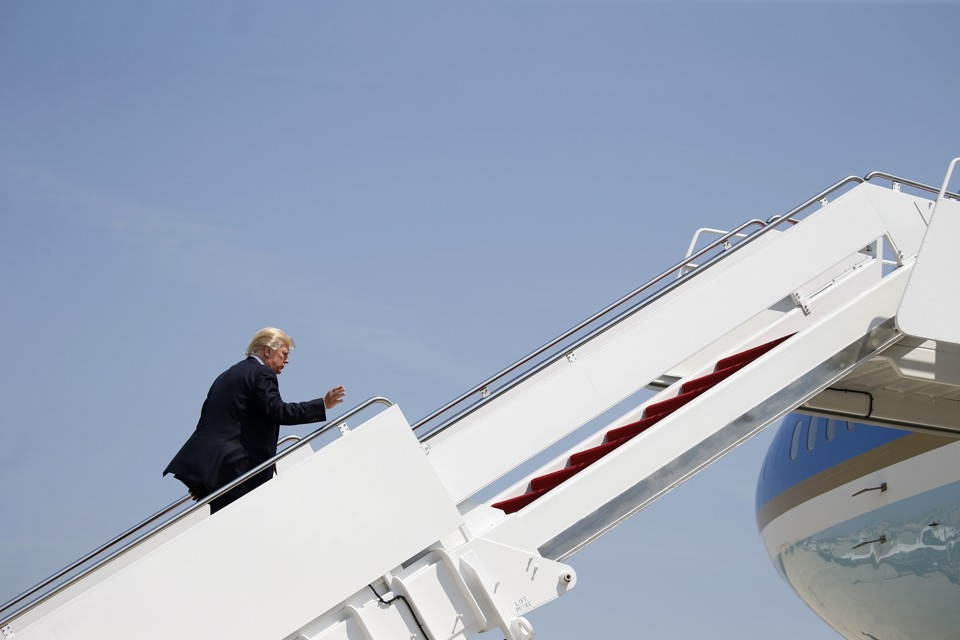 President Trump climbs aboard Air Force One