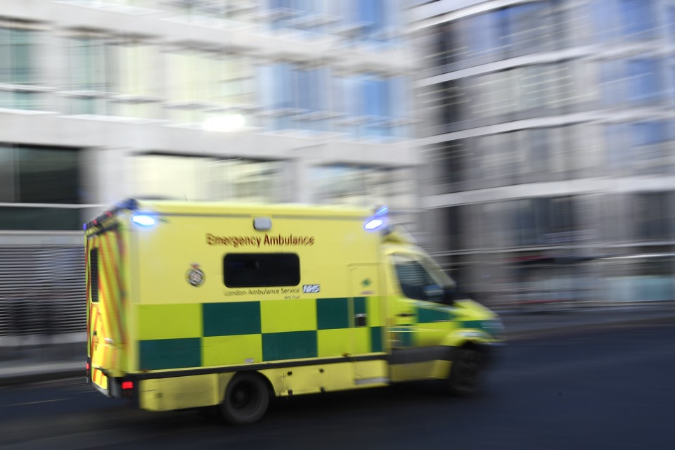 An ambulance speeds down a city street.
