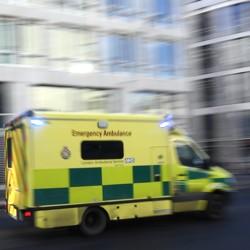An ambulance speeds down a city street.