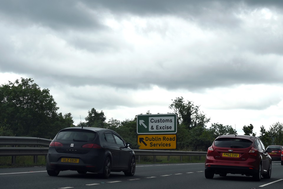 A sign for customs and excise is seen on the motorway approaching the border between Northern Ireland and Ireland on July 13, 2017.