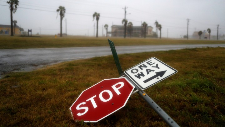 Street signs lie on the ground after winds from Hurricane Harvey intensified in Corpus Christi, Texas,