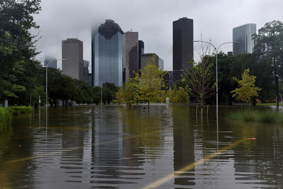 The downtown skyline reflected in the floodwater at Buffalo Bayou Park in Houston