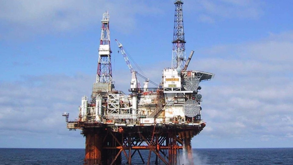 Offshore oil platform against the ocean and blue sky