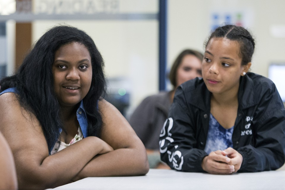 One student talks and another looks at her