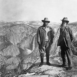 Theodore Roosevelt stands with John Muir on Glacier Point in Yosemite.