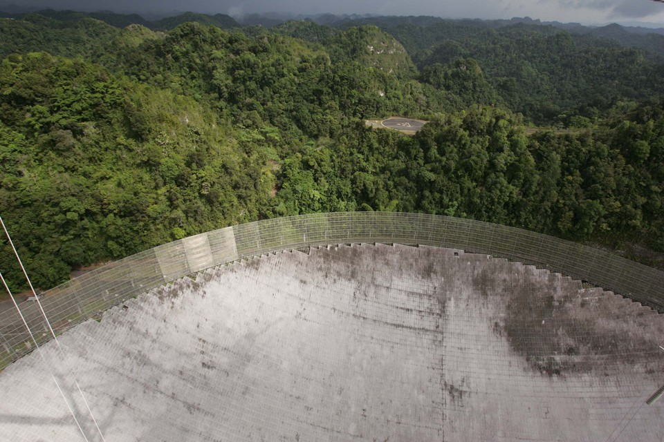 An aerial of the dish at the Arecibo Observatory in Puerto Rico