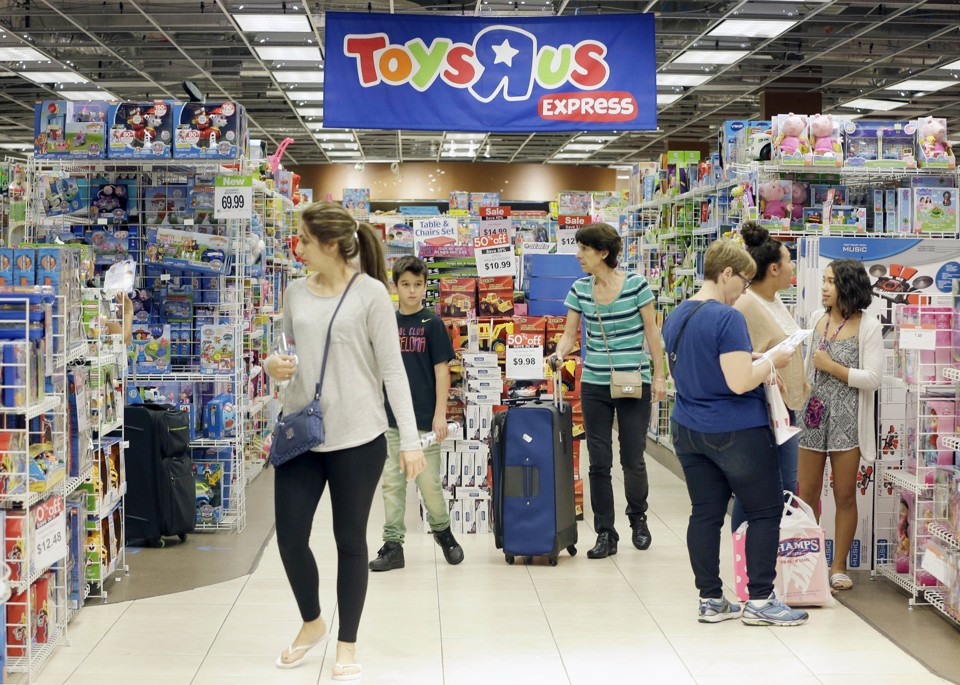 Customers shopping at Toys R Us