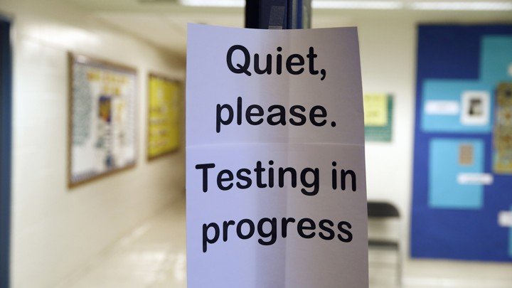 A sign asking people to be quiet while testing takes place