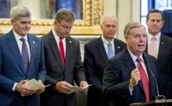 Senator Lindsey Graham speaks at a podium.