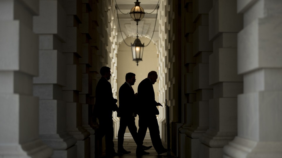 Senate Minority Leader Chuck Schumer (right) walks into the Capitol after attending a rally on Capitol Hill this week.