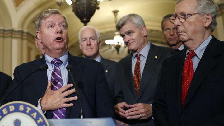 Senate Republicans address reporters at a press conference.