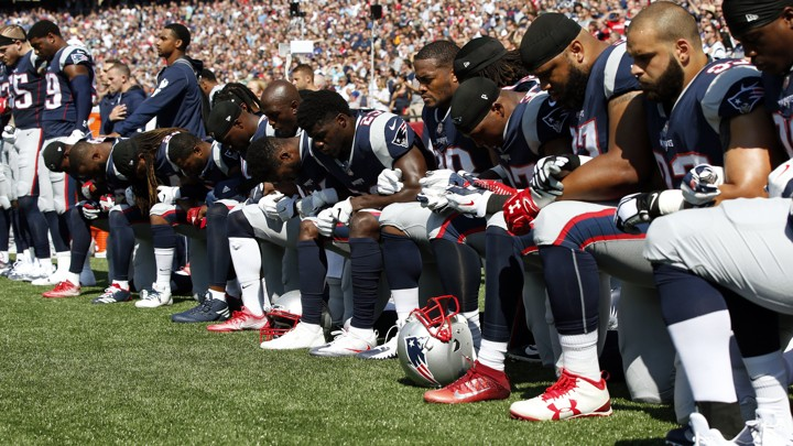 New England Patriots players kneel during the national anthem September 24, 2017.
