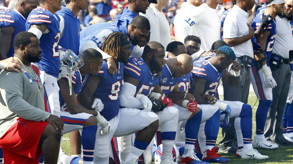 Buffalo Bills players take a knee
