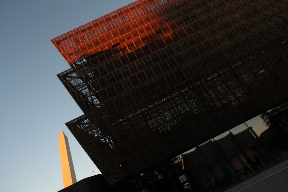 The Smithsonian's National Museum of African American History and Culture with the Washington Monument in the background