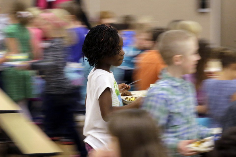 A blurry photo of students in a school cafeteria