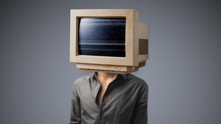 A person whose head has been replaced with a bulky desktop monitor
